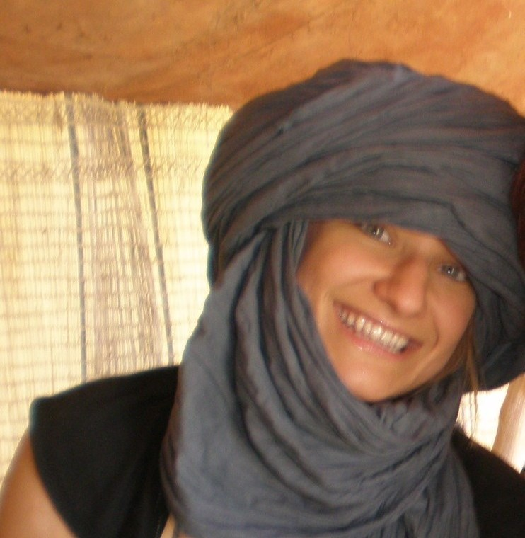 Taking shelter from the Saharan sun under a Tuareg tent and too-large turban in Timbuktu, Mali.